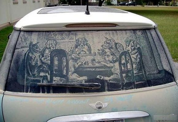 dogs gamble and drink drawing on a dirty car glass