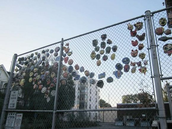 decorated fence with masks