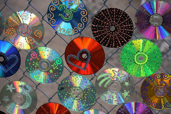 fence with decorated cd-s
