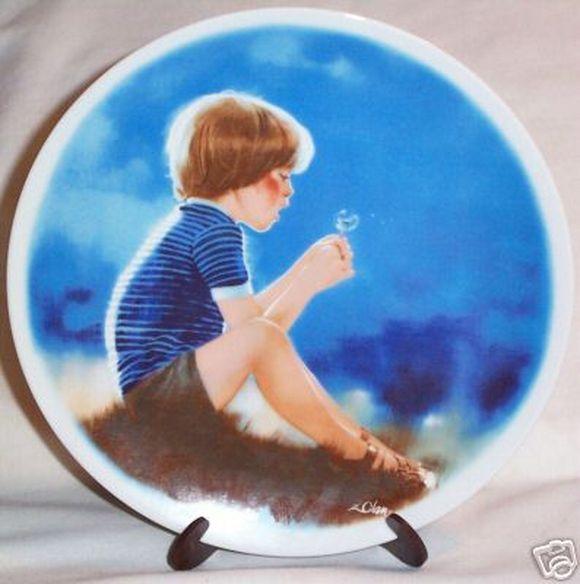 Kid blowing dandelion plate
