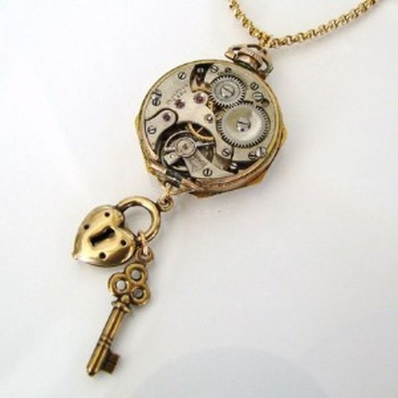 golden pocket watch with key and heart shaped lock