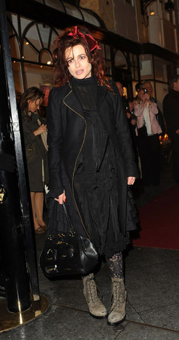 Helena Bonham Carter dressed in black with black purse papparazzi