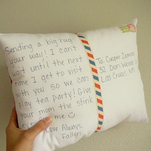postal card pillow with message writen on it