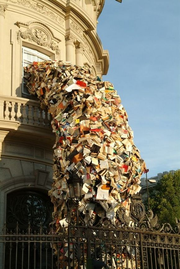 Thousands of Books Pouring Out of a Window