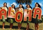 Ladies holding letters ALOHA
