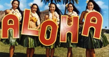 Ladies holding letters ALOHA