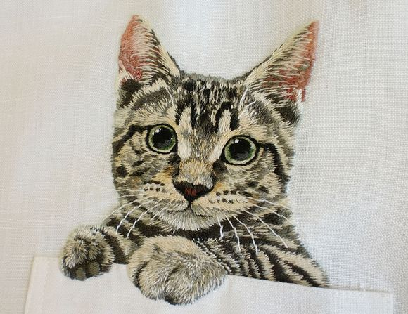 embroidery, cat peeking out of pocket