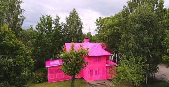 House in Finland completely covered in pink crochet