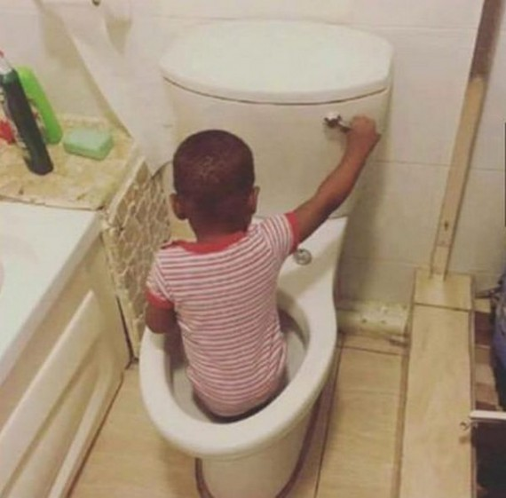 kid inside toilet