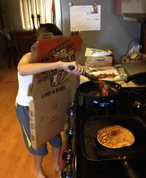 kid cooking pancakes or something